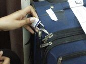 breaking of chain lock hook at pad lock location of two suitcases out of five and removal of costly items and about 900 aed.
