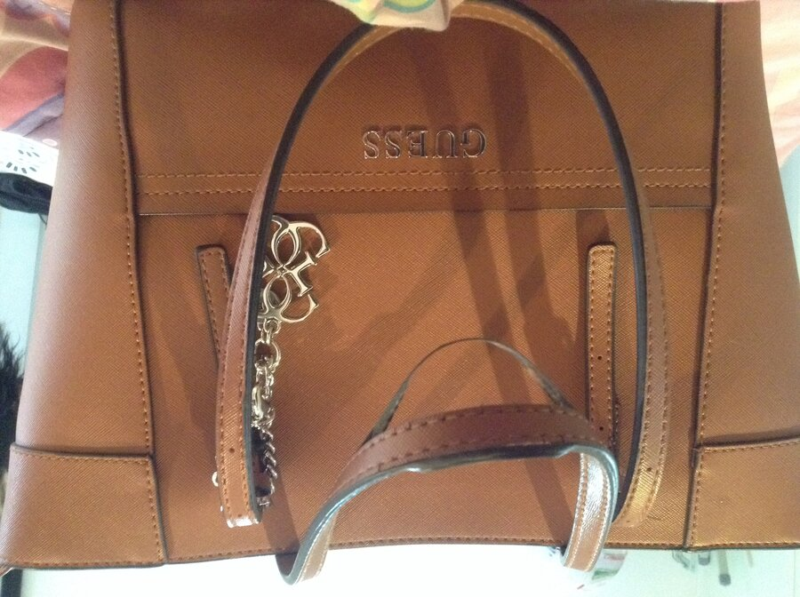 dbd858bfb06d ... which cost R1400, it s only been three months since I got this bag. The  leather from handles are coming off and cracks on the handles.