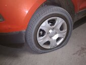 booking id: jps62k1la - asking an amount of 10000 inr for a normal tyre puncture - stating the rim was damaged