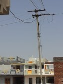 Pole tilted towards my house due to heavy storm and wire was loose power fluctuation regularly