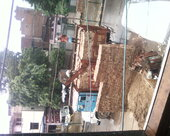 In Front of my shop Khan Building material use of road for his illegal business